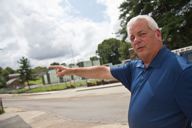 Upper Darby Township Mayor Tom Micozzie explains how the flood raced down Long Lane. (Kimberly Paynter/WHYY)