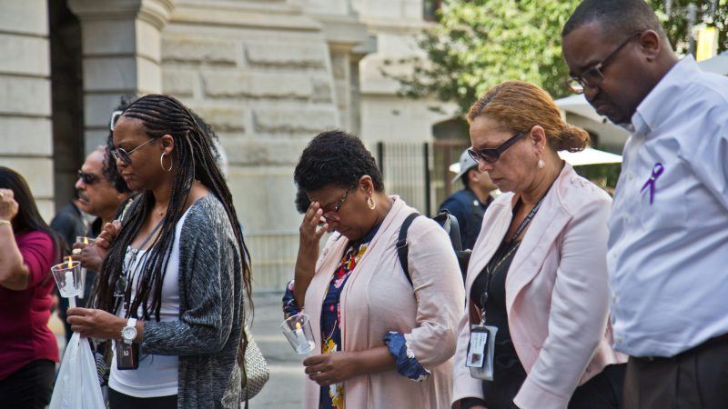 Colleagues, friends, and family of Linda Rios remember her at a candlelight vigil at City Hall courtyard Thursday afternoon. (Kimberly Paynter/WHYY)