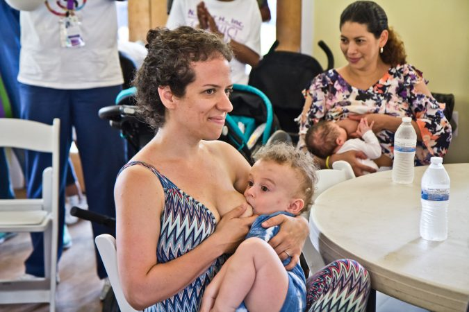 Rachel Utain-Evans breastfeeds her 15-month-old, Oliver, at the Big Latch event in Philadelphia. (Kimberly Paynter/WHYY)