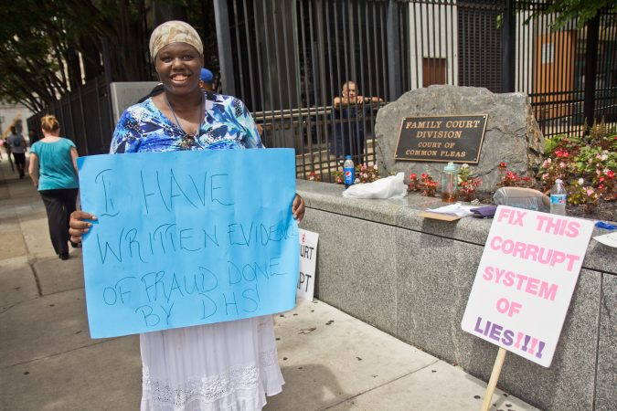 Antoinette Richardson protests outside Family Court Friday. She's been separated from her children for three years. (Kimberly Paynter/WHYY)