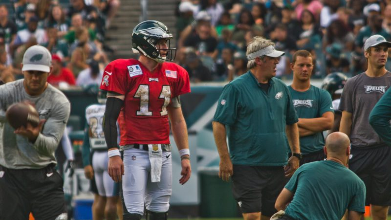 Eagles head coach Dough Pederson (right) and starting quarterback Carson Wentz on the field at the team's open practice Sunday evening. (Kimberly Paynter/WHYY)