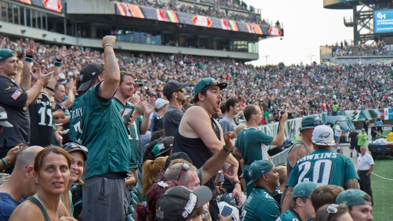 Excited Eagles fans cheer for the team at their first open practice of the season at Lincoln Financial Field Sunday evening. (Kimberly Paynter/WHYY)