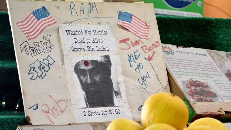 A homemade dartboard with a picture of Osama Bin Laden is found amid the produce at Zern's Farmers Market in Gilbertsville, Pa., on Aug. 24, 2018. (Bastiaan Slabbers for WHYY)
