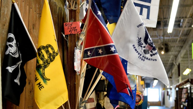 Stick flags are sold from a booth at Zern's Farmers Market in Gilbertsville, Pa. (Bastiaan Slabbers for WHYY)
