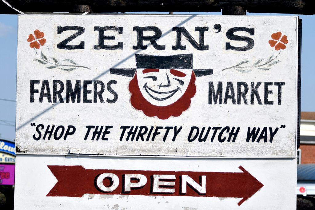 """Shop the thrifty Dutch way,"" reads a sign welcoming visitors to Zern's Farmers Market in Gillberstville, Pa."