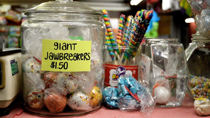 A jar of giant jawbreakers dominates the counter at the candy store, a popular stall at Zern's Farmers Market in Gilbertsville, Pa. (Bastiaan Slabbers for WHYY)
