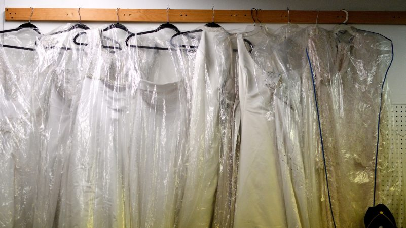 Wedding dresses are sold from a stall at Zern's Farmers Market in Gilbertsville, Pa. (Bastiaan Slabbers for WHYY)