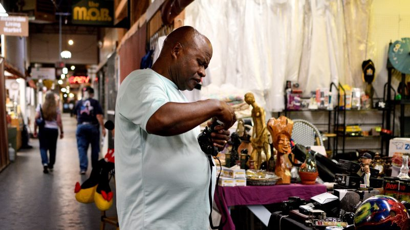 A vendor attends to his thrift shop at Zern's Farmers Market in Gilbertsville, Pa. (Bastiaan Slabbers for WHYY)
