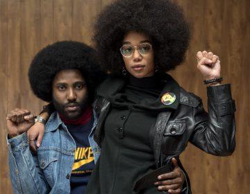 Ron (John David Washington) and Patrice (Laura Harrier) strike power poses in Spike Lee's BlacKkKlansman. (David Lee/Focus Features)