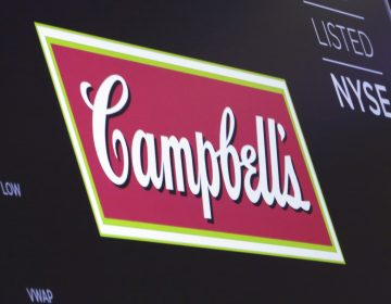 The logo for Campbell's Soup appears above a trading post on the floor of the New York Stock Exchange, Friday, May 18, 2018. Campbell Soup plunged 10.9 percent after announcing that its CEO, Denise Morrison, was retiring effectively immediately. (Richard Drew/AP Photo)