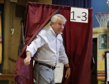 Republican U.S. Senate candidate Bob Hugin exits a voting booth in the June New Jersey primary election. A new Quinnipiac poll shows he's gaining momentum in his race against incumbent Democrat Bob Menendez. (AP Photo/Julio Cortez)