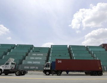 FILE- In this June 29, 2017, file photo containers are stacked up in Elizabeth, N.J., as a truck drives by at Port of Elizabeth. The U.S. has threatened to impose 25 percent duties on $34 billion in Chinese products starting Friday, July 6, 2018, and China has said it will fire back with corresponding tariffs. (AP Photo/Julio Cortez, File)
