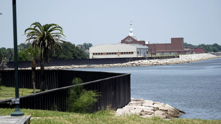 "A seawall, which will be increased in size, is shown along the banks near downtown Thursday, July 26, 2018, in Port Arthur, Texas.  The oil industry wants the government to help protect some of its facilities on the Texas Gulf Coast against the effects of global warming. One proposal involves building a nearly 60-mile ""spine"" of flood barriers to shield refineries and chemical plants. Many Republicans argue that such projects should be a national priority. But others question whether taxpayers should have to protect refineries in a state where top politicians still dispute whether climate change is real. (David J. Phillip/AP Photo)"