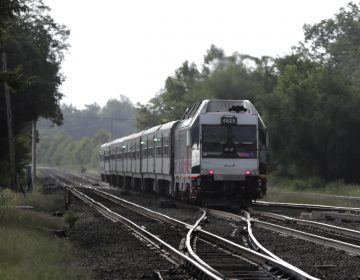 A New Jersey Transit train leaves the Bound Brook Station in New Jersey. Commuters have faced many train cancellations recently. (AP Photo/Julio Cortez)