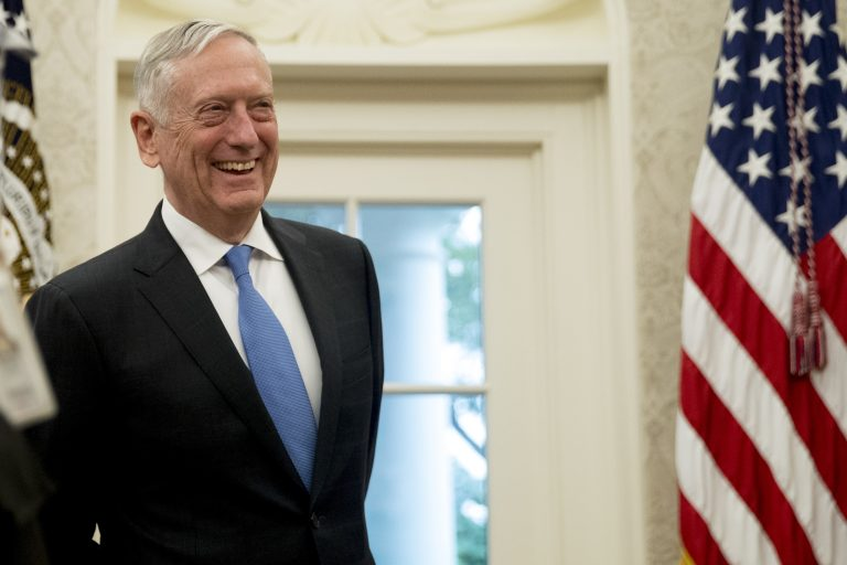 In this July 30, 2018, file photo, Defense Secretary Jim Mattis attends a swearing in ceremony for Robert Wilkie as Secretary of the Department of Veterans Affairs in the Oval Office of the White House in Washington. President Donald Trump wants a Space Force, a new military service he says is needed to ensure American dominance in space. But the idea is falling flat at the Pentagon, where Mattis has said it would add burdensome bureaucracy and costs. (Andrew Harnik/AP Photo)