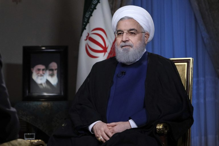 In this photo released by official website of the office of the Iranian Presidency, President Hassan Rouhani addresses the nation in a televised speech in Tehran, Iran, Monday Aug. 6, 2018. The U.S. is bracing for cyberattacks Tehran could launch in retaliation for sanctions President Donald Trump has slapped back on Iran, cybersecurity and intelligence experts warn (Iranian Presidency Office via AP)
