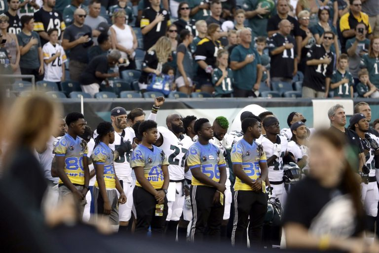 Philadelphia Eagles' Malcolm Jenkins, center left, raises his fist during the national anthem before the team's preseason NFL football game against the Pittsburgh Steelers, Thursday in Philadelphia. (AP Photo/Matt Rourke)