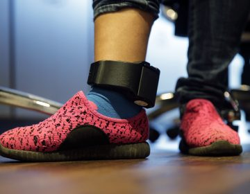 In this Monday, July 23, 2018, file photo, Immigrant seeking asylum Ildra Medreano wears an ankle monitor at a Catholic Charities facility not long after she was reunited with her son in San Antonio. Federal authorities' shift away from separating immigrant families crossing into the U.S. illegally now means that many parents and children are quickly released from custody only to be fitted with electronic monitoring devices, a practice that has spiked in recent years but which both the government and advocacy groups oppose for different reasons. (AP Photo/Eric Gay)