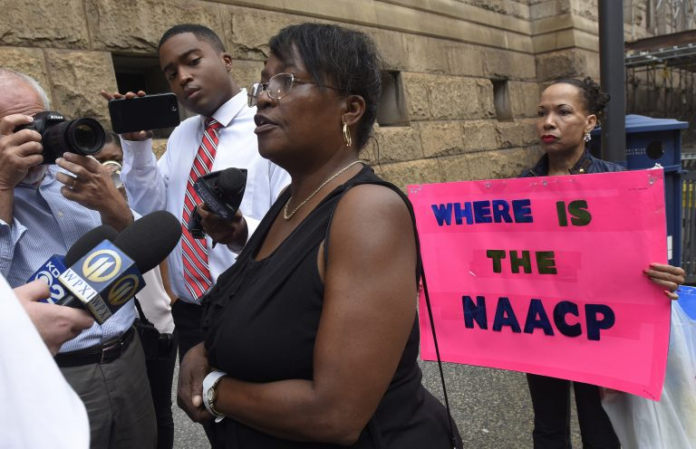 Carmen Ashley, great aunt of Antwon Rose Jr. talks with reporters outside of the courthouse following a hearing for East Pittsburgh police officer Michael Rosfeld on Wednesday, Aug. 22, 2018, in Pittsburgh.  Rosfeld is charged in the June 19 shooting death of Rose, an unarmed teenager as he fled a traffic stop. (AP Photo/Don Wright)