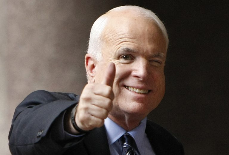 In this Sept. 28, 2008 file photo, Republican presidential candidate, Sen. John McCain, R-Ariz., gives a thumbs up as he arrives at his campaign headquarters in Arlington, Va.  McCain's family says the Arizona senator has chosen to discontinue medical treatment for brain cancer.  (Gerald Herbert/AP Photo)