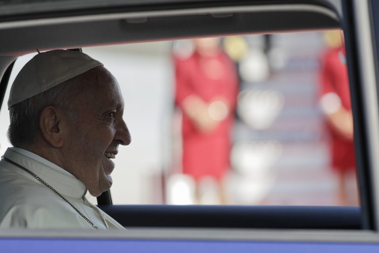 Pope Francis sits in a car