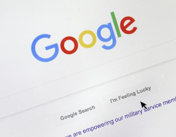 A cursor moves over Google's search engine page on Tuesday, Aug. 28, 2018, in Portland, Ore. (Don Ryan/AP Photo)