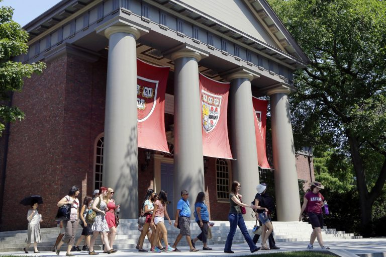 In this Aug. 30, 2012, file photo, a tour group walks through the campus of Harvard University in Cambridge, Mass. The Justice Department has sided with Asian-American students suing Harvard University over the Ivy League school's consideration of race in its admissions policy. (Elise Amendola/AP Photo, File)