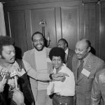 Rev. Jesse Jackson speaks to reporters at the Operation PUSH Soul Picnic at the 142nd Street Armory in New York, March 26, 1972. Left to right are: Jackson; Tom Todd, vice president of PUSH; Aretha Franklin and Louis Stokes, rear right. PUSH stands for People United to Save Humanity. (AP Photo/Jim Wells)