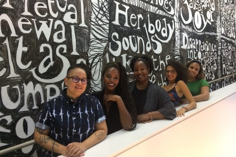 Blackstar organizers Meg Onli, Patrice Worthy, Maori Karmael Homes, Nehad Khader, and Denise Beek in front of an artwork by Jade Montserrat at the Institute for Contemporary Art. Blackstar highlights the work of black filmmakers from around the world. (Credit: Jen Kinney)