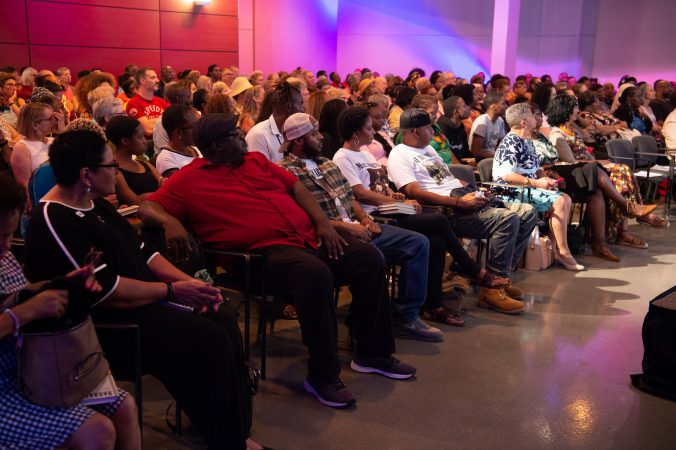 Audience members listen during an event at WHYY to celebrate the publishing of