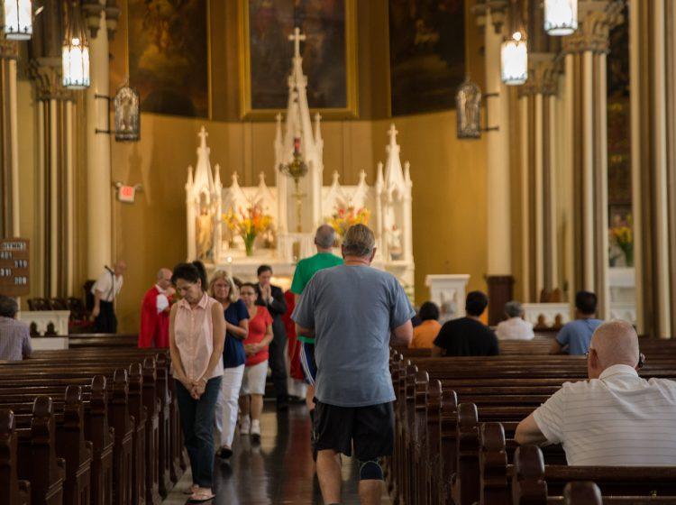 Parishioners receive communion at Holy Infancy Roman Catholic in Bethlehem, Pennsylvania, part of the Allentown Diocese. (Lindsay Lazarski/WHYY)