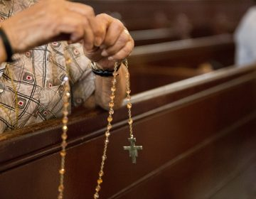 Parishioners pray the Rosary at Holy Infancy Roman Catholic in Bethlehem, Pennsylvania after mass on Tuesday, August 14, 2018, the same day, Pennsylvania Attorney General released his two-year grand jury investigation into widespread sexual abuse and cover-up within six Catholic dioceses across the state. (Lindsay Lazarski/WHYY)