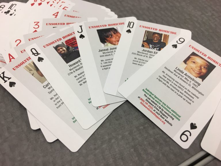 Police in Delaware will distribute decks of playing cards that have pictures and stories of unsolved murders in hopes that inmates will join their effort to solve the crimes. (Mark Eichmann/WHYY)