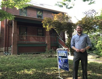 State College borough planning director Ed LeClear in front of one of the houses sold through the Neighborhood Sustainability Program. (EMILY REDDY / WPSU)
