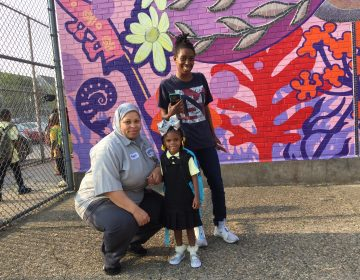 Quimayah Gibson-McClendon prepares for her first day of kindergarten at William Dick School in North Philadelphia with her great-aunt Elesha Sears (left), and grandmother Tashawn McClendon, (Avi Wolfman-Arent/WHYY)