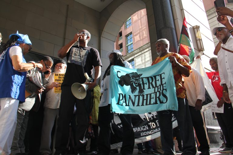 Supporters of Mumia Abu-Jamal, convicted in the 1981 murder of a Philadelphia police officer,  gather Thursday outside the Criminal Justice Center where a judge was considering whether Abu-Jamal's appeals should be reinstated. (Emma Lee/WHYY)