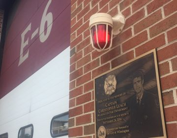A plaque dedicated to Christopher Leach, one of three Wilmington firefighters killed in a September 2016 fire, is affixed to Station 6.. The term E6 refers to Engine 6, water-carrying truck that normally operates out of the station, but was mothballed the night the trio died  while battling the blaze. (Cris Barrish/WHYY)