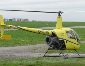 A public domain image of a Robinson R22 Beta II helicopter.
