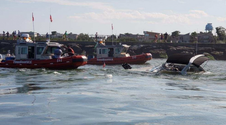 Commercial salvage crews arrive at the scene of a partially sunken boat in the Barnegat Inlet Thursday. (USCG image)