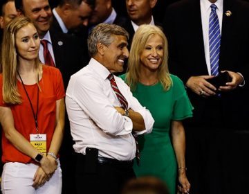 Senate candidate Rep. Lou Barletta, R-Pa., meets with Counselor to the President Kellyanne Conway as President Donald Trump speaks during a rally, Thursday, Aug. 2, 2018, at Mohegan Sun Arena at Casey Plaza in Wilkes Barre, Pa. (AP Photo/Matt Rourke)