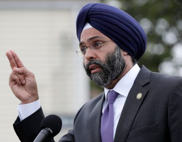 New Jersey Attorney General Gurbir Grewal speaks during a news conference. (AP Photo/Julio Cortez)