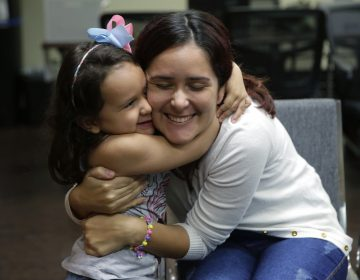 Natalia Oliveira da Silva and her daughter, Sara, 5, hug at a Catholic Charities facility in San Antonio, TX. They were separated in late May. (Eric Gay/AP)