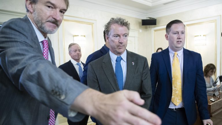 Sen. Rand Paul, center, and his communications director Sergio Gor, right, enter a hall during their meeting with Russian lawmakers in Moscow Monday. (Pavel Golovkin/AP)
