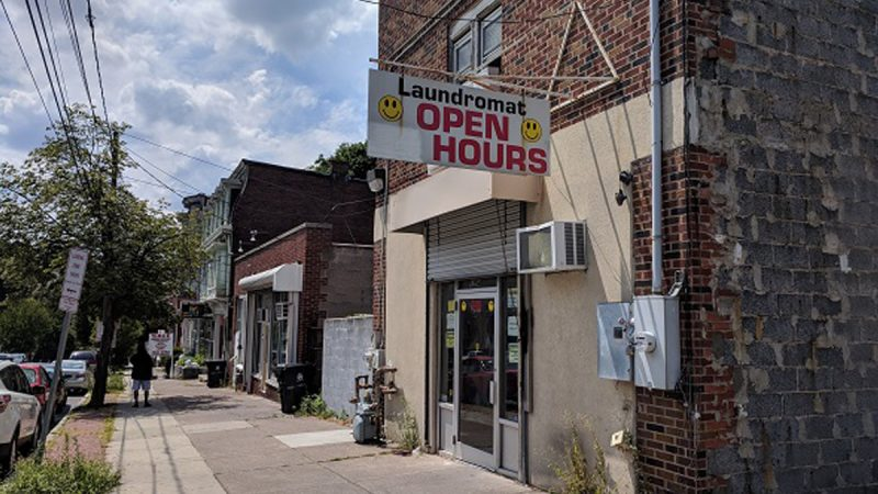 The founders of Harris Family Brewery plan to open their brew pub above this laundromat on 13th and Market streets in Allison Hill. (Rachel McDevitt/WITF)