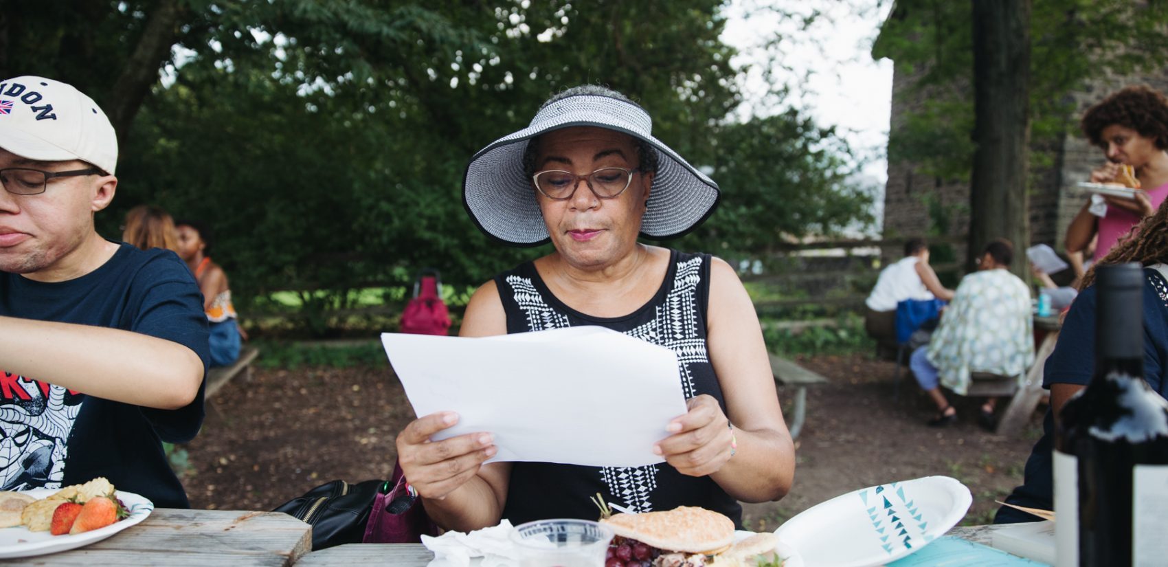 Carol McCullough reading Jesmyn Ward. | Neal Santos for PlanPhilly