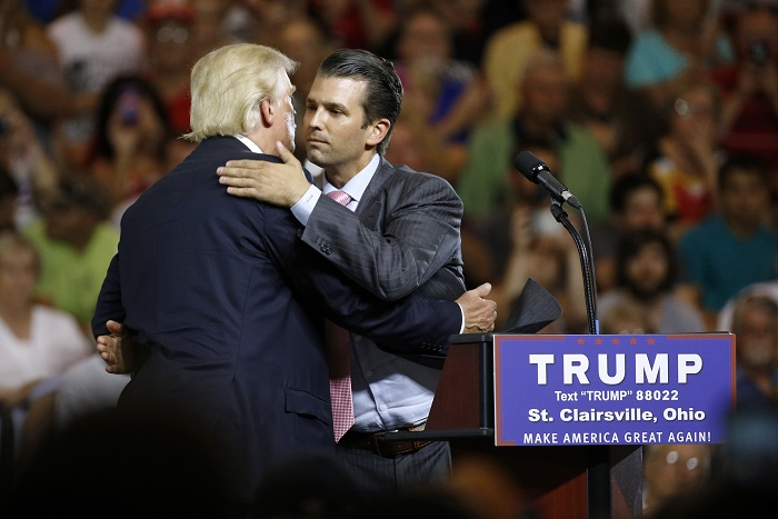Republican presidential candidate Donald Trump, left, hugs his son Donald Trump Jr. during a rally at Ohio University Eastern Campus in St. Clairsville, Ohio, Tuesday, June 28, 2016. (AP Photo/Patrick Semansky)
