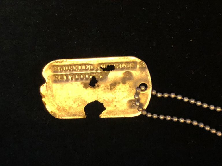 The single dog tag in the 55 boxes of human remains turned over to the U.S. by North Korea last week was still readable. It was presented to Master Sgt. Charles Hobert McDaniel's two sons at a ceremony on Wednesday. (Jay Price /Member station WUNC)