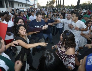 Protesters surround a Trump supporter on S. Almaden Boulevard outside the San Jose Convention Center as Presidential candidate Donald Trump holds a rally in San Jose, Calif., Thursday, June 2, 2016. (Patrick Tehan/Bay Area News Group Archives)
