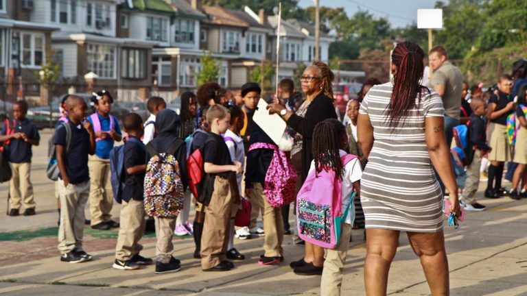 Students line up outside Joseph Pennell Elementary on the first day of school. (Kimberly Paynter/WHYY)