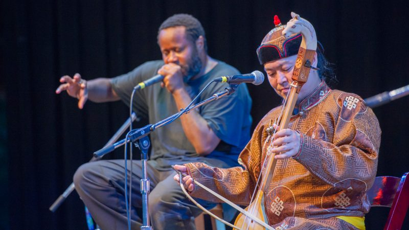 The Tuvan throat singing group Alash was joined by Baltimore based beat boxer Shodekeh, left, for the Saturday evening concert. (Jonathan Wilson for WHYY)